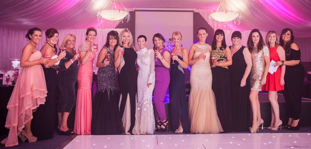 Women helped by the Marina Dalglish Appeal pose before their big fashion show
