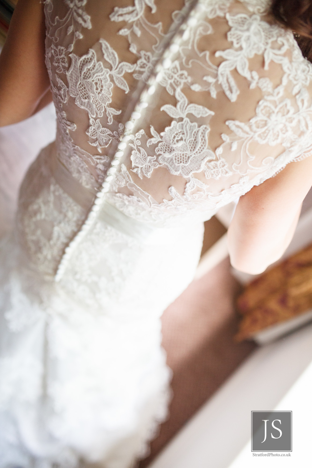 The elegant lace back of a wedding dress.jpg