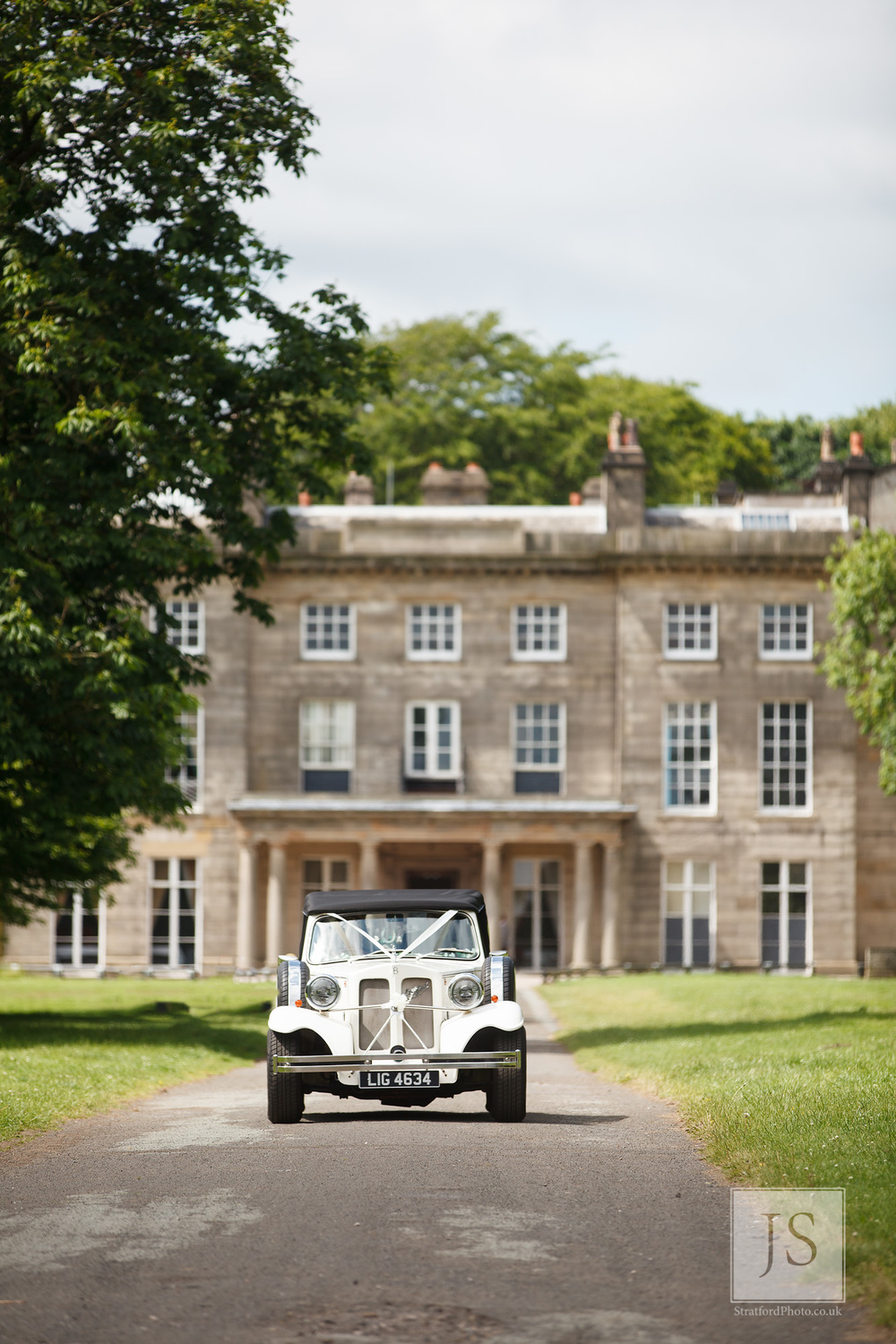 A classic Bentley drives down the driveway at Heigh Hall.jpg