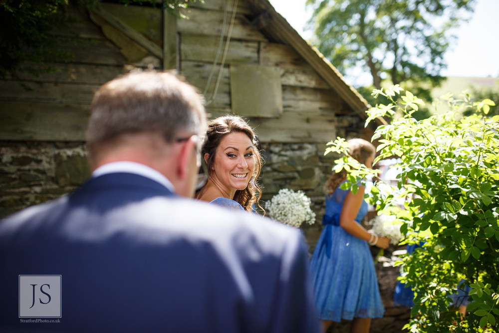 A bridesmaid smiles at her father.jpg