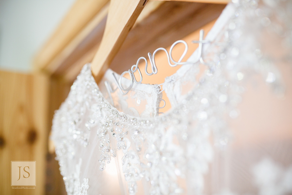 A coathanger shows the brides new name.jpg