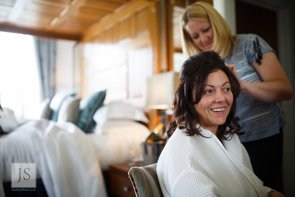 A bride has her hair done on her wedding morning.jpg
