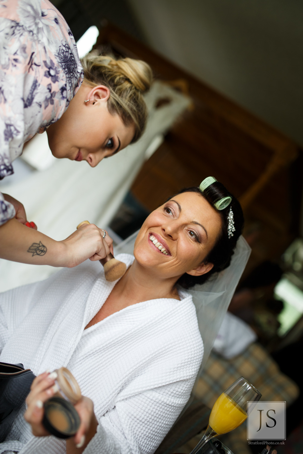 A bride has her makeup done.jpg
