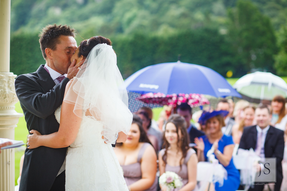 A groom kisses his bride at the altar.jpg