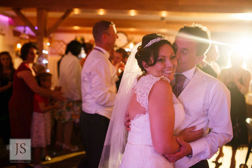 A groom kisses his bride at the end of their first dance.jpg