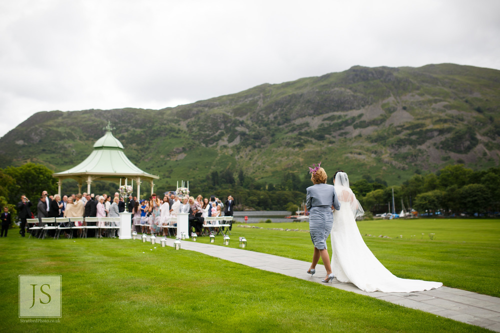 A mother and bride walk down the aisle at Ullswater.jpg