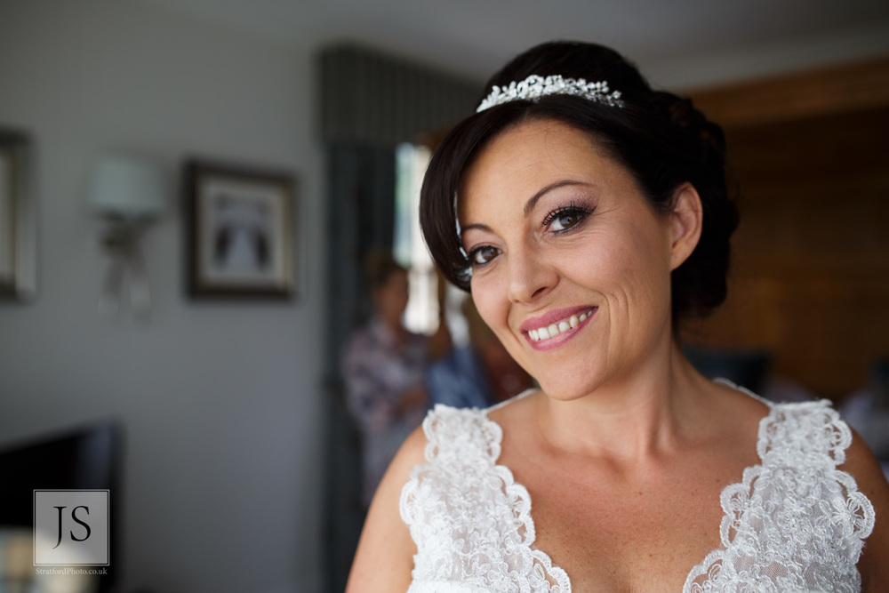 A radiant bride smiles on her wedding morning.jpg