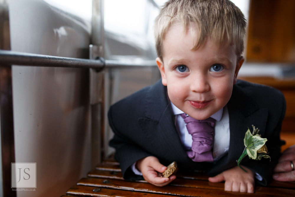 A young ring bearer smiles at the camera on a Lake Ullswater steamer boat.jpg