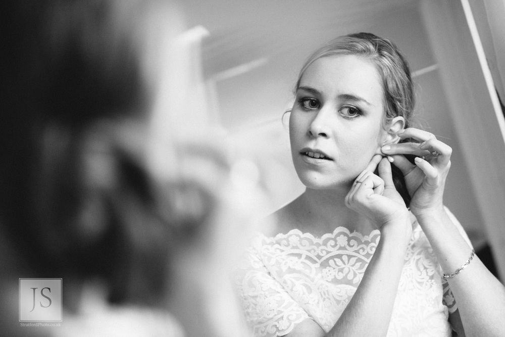A bride puts her earrrings on.jpg