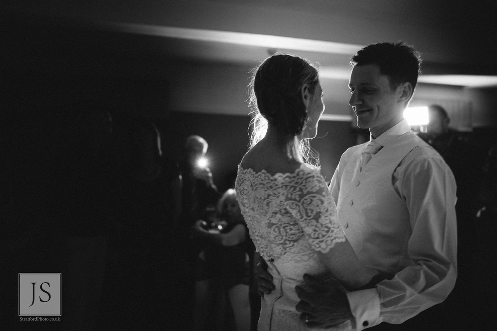 A bride and groom share their first dance.jpg