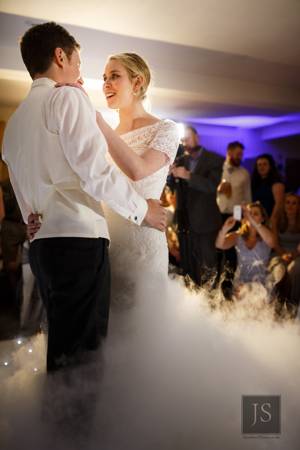 A bride and groom share their first dance in dry ice.jpg