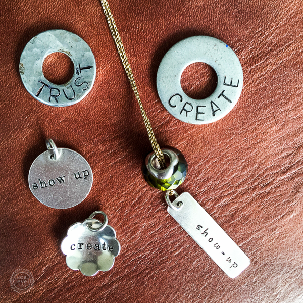 Words of the Year from 2014 & 2015. My sister made the washers. The charms are by The Vintage Pearl.