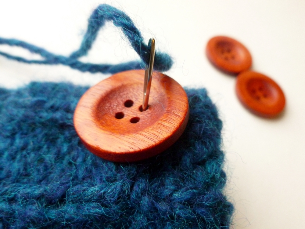 How to Sew on a Button with Handspun Yarn | withwool.com