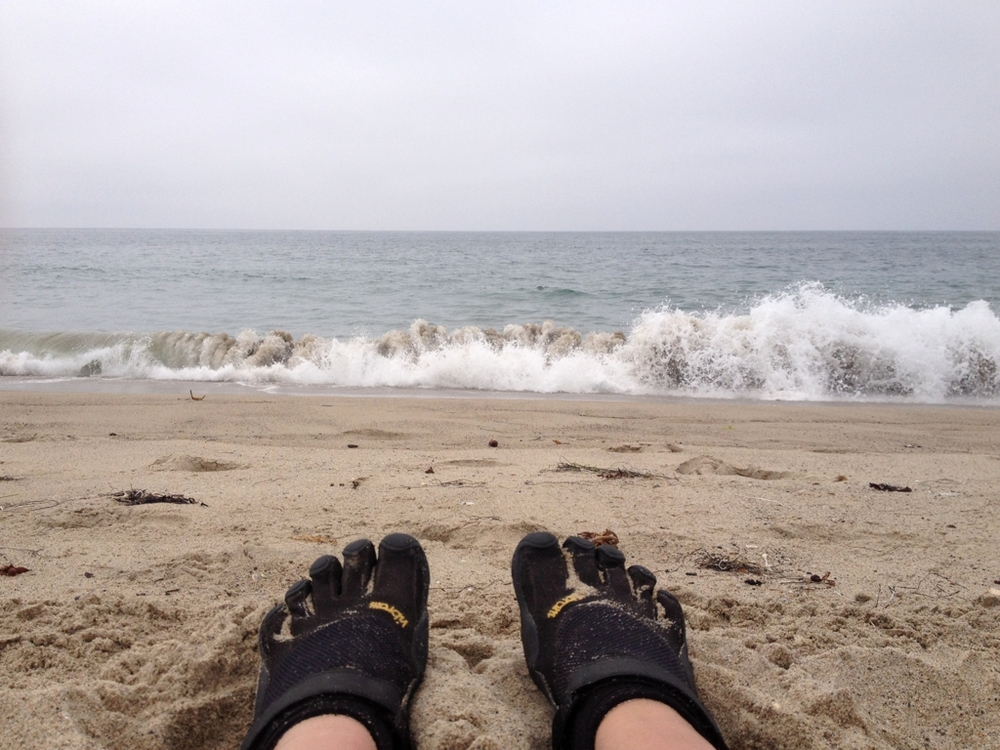The beach is the perfect place to rest my legs in the middle of a long bike ride.