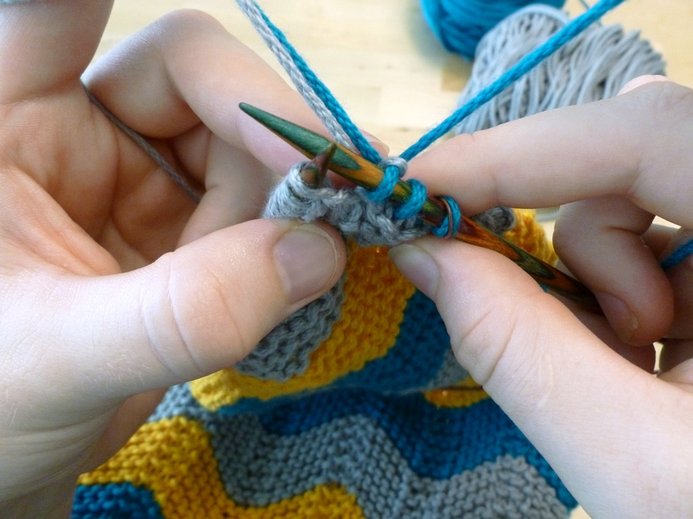 Learn how to weave in ends without a tapestry needle as you knit!   | withwool.com