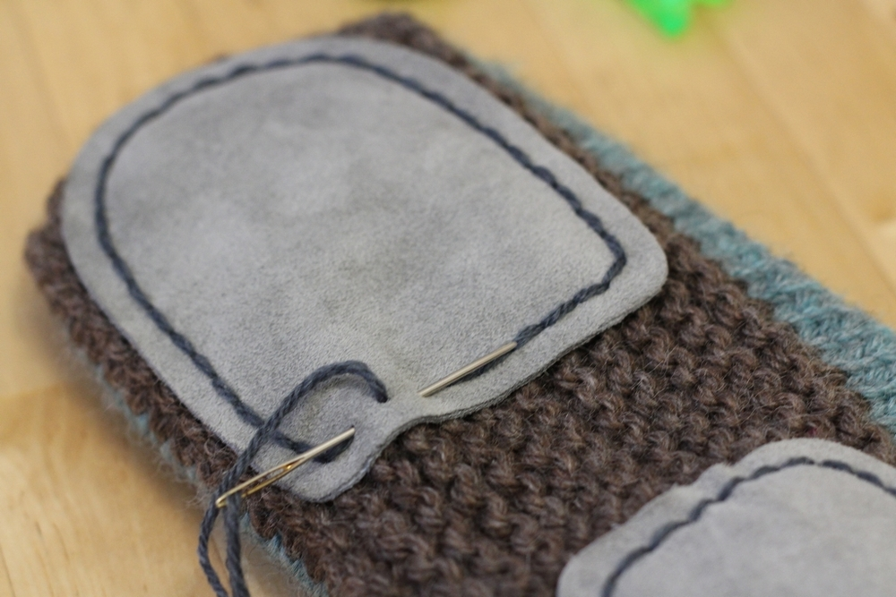 Who knew slippers were so quick and fun to make? Sewing on the soles did take a good chunk of time though, but the work was definitely worth it. They gave the slippers structure and a bit of slip resistance. | FO: Non-Felted Slippers and Practical Washcloths - withwool.com