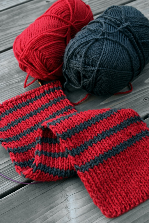 I'm knitting a cushy scarf in red and grey for the Red Scarf Project. | withwool.com