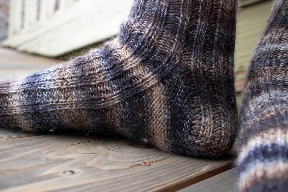 My first pair of handspun socks is off the needles and on to happy feet! | withwool.com