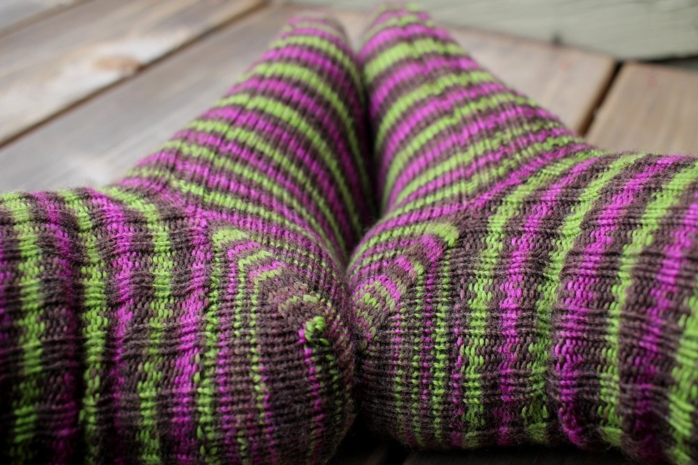 Toe-up socks with afterthought cuffs make perfect travel knitting. | withwool.com