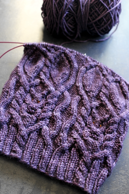 Cables, owls, and beautiful yarn make a hat that's hard to put down. #knitting | withwool.com
