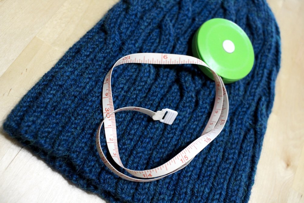 How to check knitting gauge in ribbing, and what the pattern means when it says stretched, unstretched, and blocked. | withwool.com