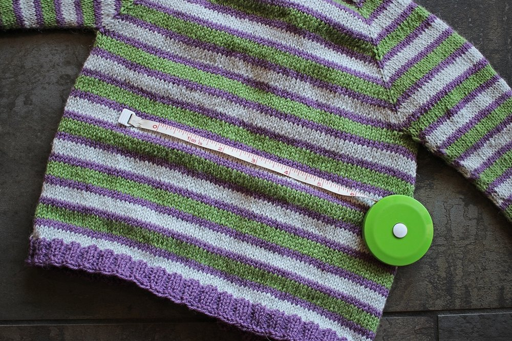The sweater is washed and blocked. Did the different method of swatching tell the truth? Is my sweater the same size it was before washing? Yes and yes!  #knitting | withwool.com