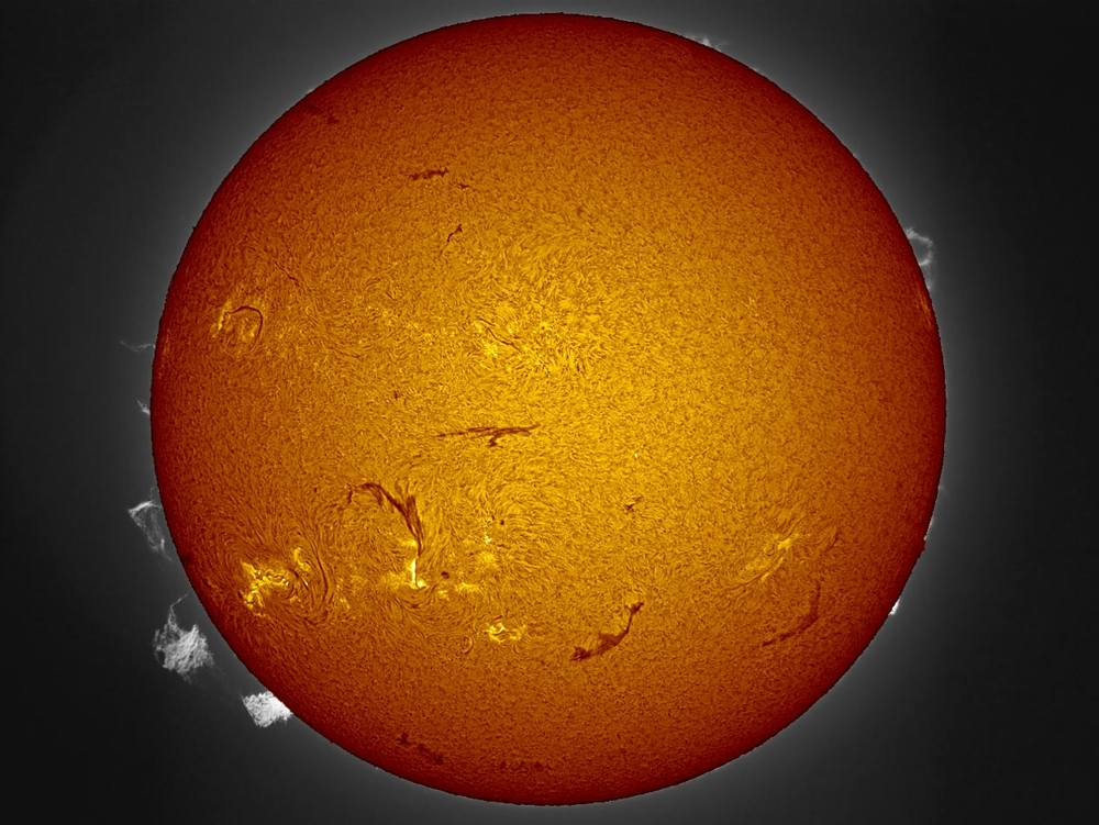 """One prominence lifting off and another large one watches. Luntanado and DMK 41 camera---July 28 2012 Jim"""