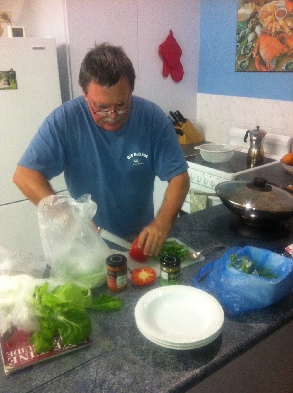 Dennis making dinner