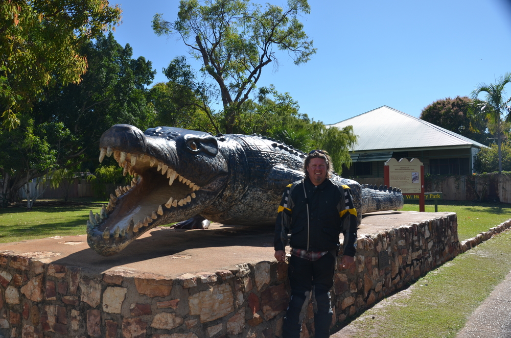 Cat standing next to a model of Krys the largest crocodile ever captured at 28 ft, 4 in.