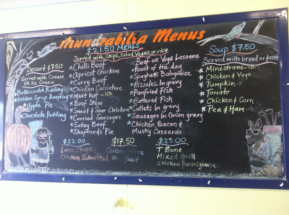 Mundrabilla Roadhouse Menu. We packed up from our bush camp knowing that a roadhouse was only 40 k's down the road. Kev and I both had snags and scrambled eggs for brekky. Ready for another day!