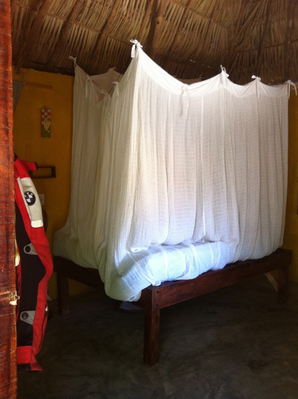 The bungalow had a double bed with a mozzie net, toilet and cold water shower.