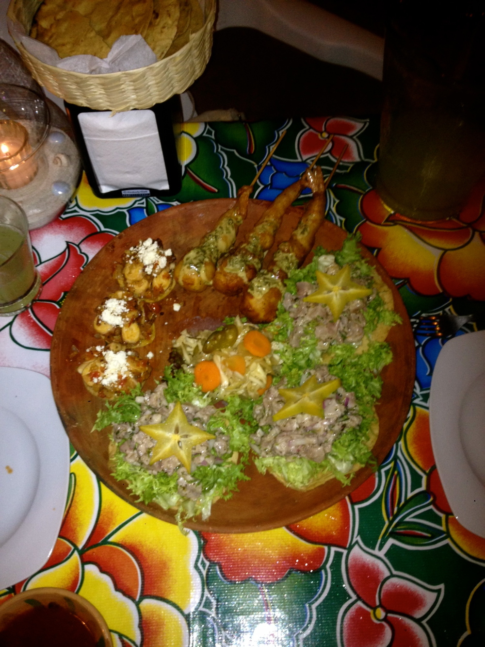 An amazing plate of fresh atun, tuna tostadas, pulpo, octopus sopes and a cameron, prawn paired with a local quseo crown, deep fried.