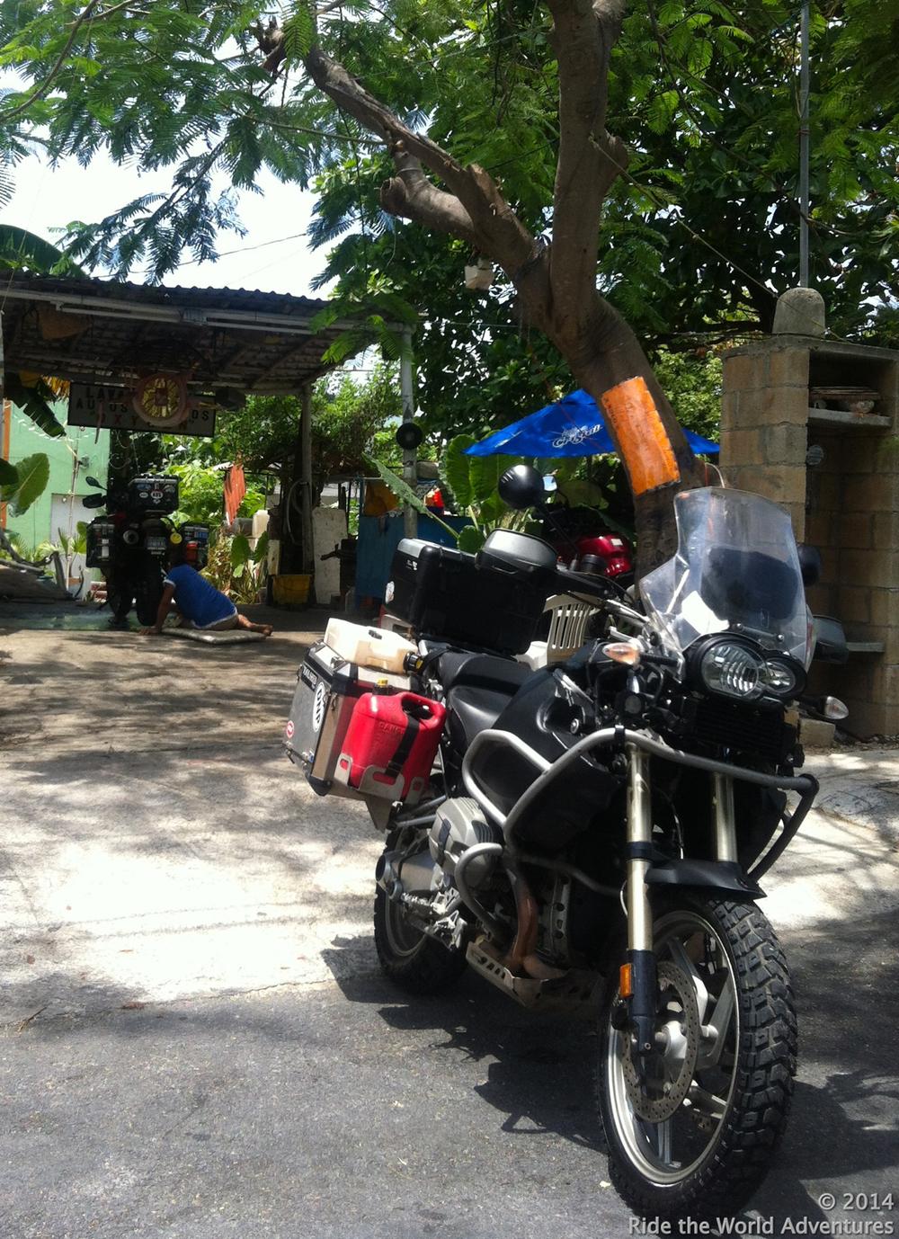 "Bikes getting a thorough wash at the "" lavado de autos"""