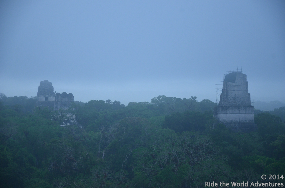 Waiting for the sunrise on the steep steps of the highest temple of Tikal (65 mts),    perched high in the cool mist marveling over the wonders of the Tikal canopy.  This temple was built in 745 A.D. and is known as the Temple of the Two Headed Snake.