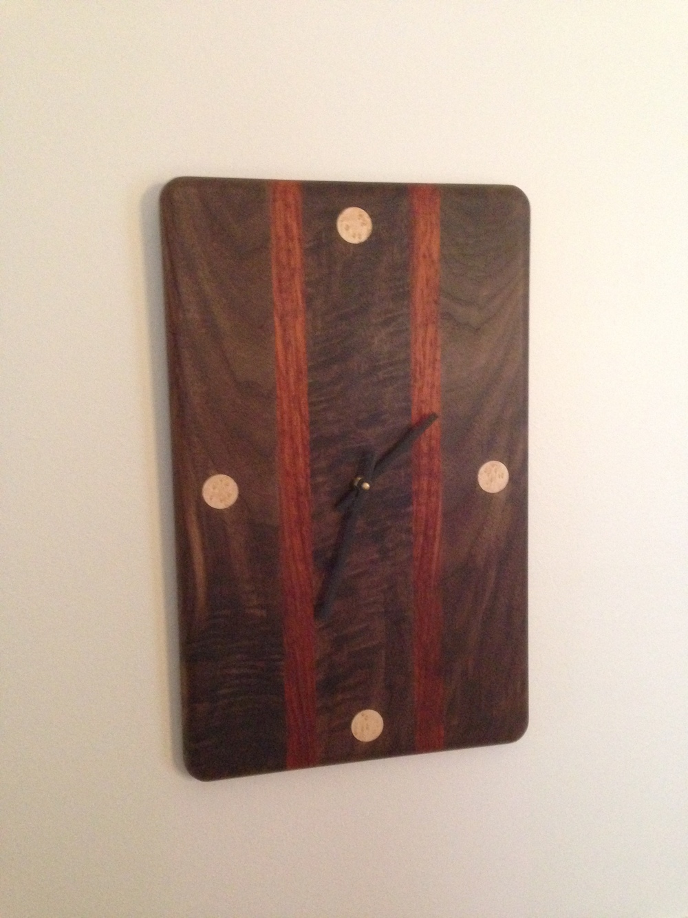 Black walnut with burl, padauk vertical stripes, and birdseye maple major hour markers.