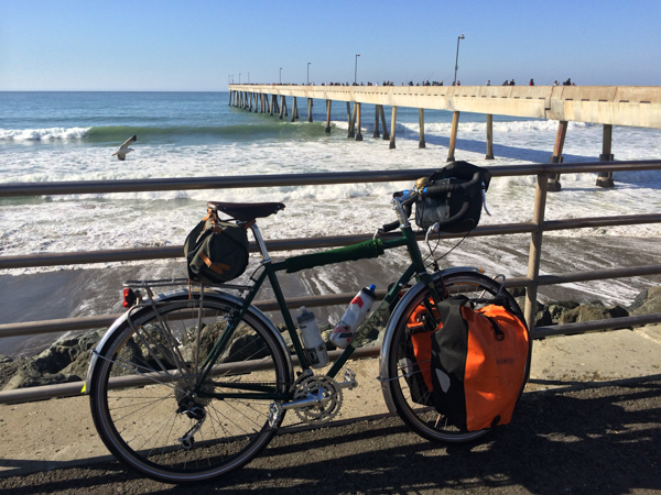 Tubus racks front and rear, showing off an alternative way to carry your panniers. Pacifica Pier in the background.