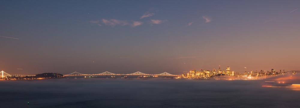 Angel Island twilight view to San Francisco Bay Bridge lights fog