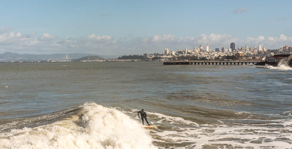 surfer next to san francisco.jpg