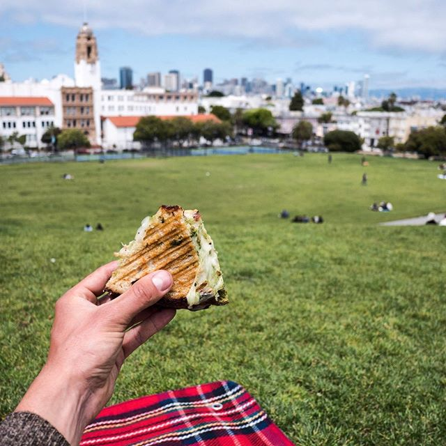 Tour lunch with a legendary sandwich from @tartinebakery at Dolores Park.  The best eats in SF, every bike tour #nobasicshit #morethanabiketour