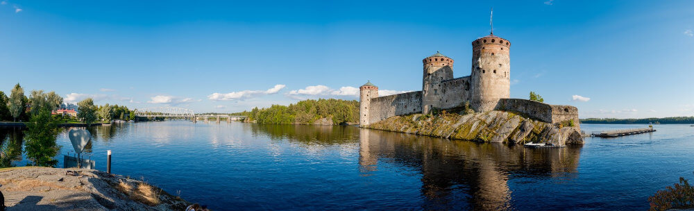 Savonlinna, Finland, Olavinlinna Castle -medieval arms clashing, cannons roaring and people doing everyday chores inside the security of the castle's thick walls.