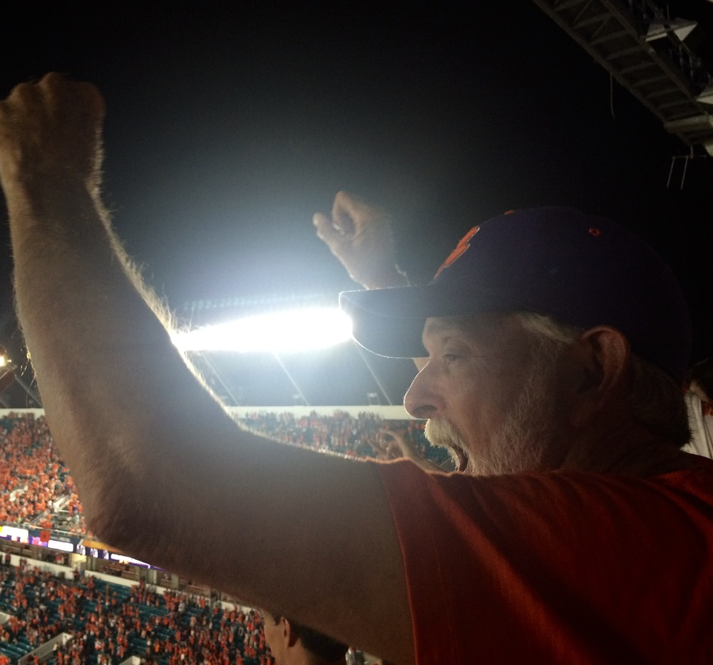 Happy Daddy after Clemson closes out 37-17 victory against Oklahoma, earning a shot at Alabama for the national title.