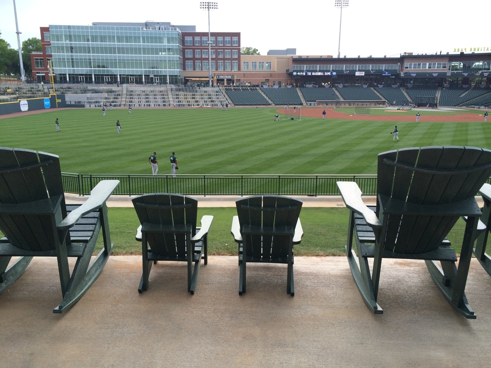 The rocking chairs along the left-field fence come in both adult- and child-sized.