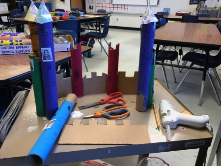 Each student got to paint and design a paper towel tube. I located scrap cardboard and we started playing with castle designs.
