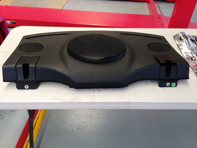 Customised rear shelf to make a feature of the new sub-woofer while keeping in line with the factory theme.