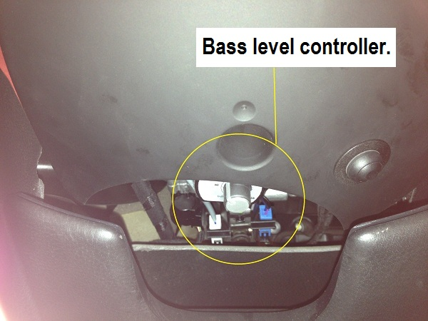 the Bass level controller is placed out of sight under the steering column, yet easy to get to for the driver.