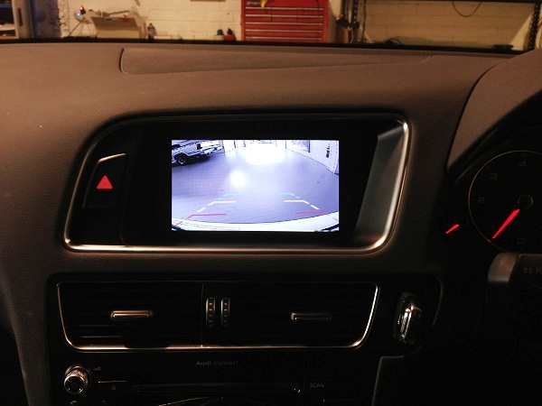 The rear camera image auto switches to the factory screen.