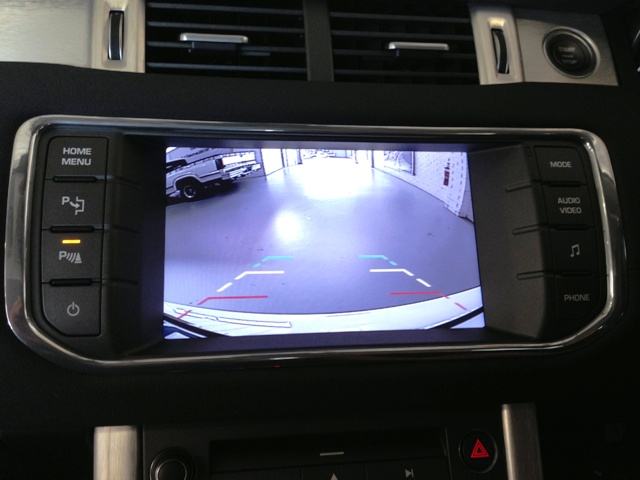 The wide angle rear view camera auto switches in reverse.