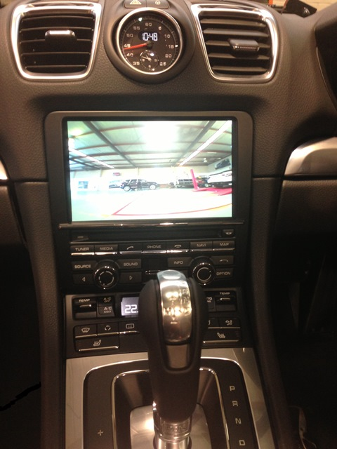The rear view camera is displayed on the factory PCM screen.