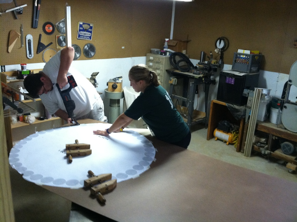 Lora and Brandon working hard, cutting out the Masonite layers