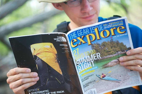 Taking a break from paddling to catch up on the latest issue
